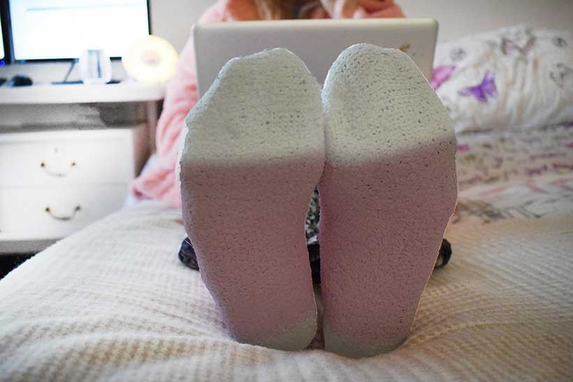 brie-annes socks and feet while she works in bed on her macbook