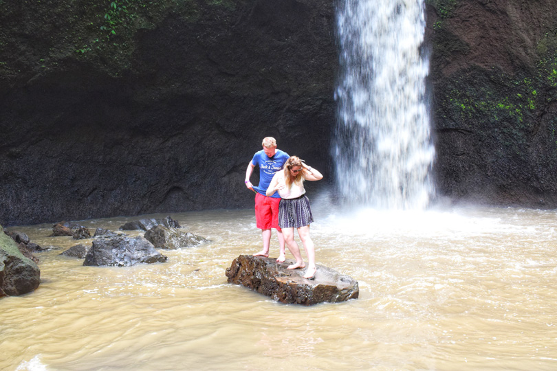 goofing around at a waterfall in bali