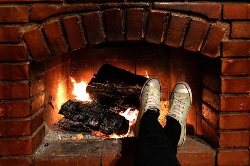 feet-in-front-of-fireplace-relaxing-on-boxing-dayfeet-in-front-of-fireplace-relaxing-on-boxing-day