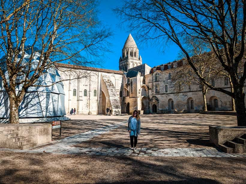 Brie-anne-stood-in-front-of-the-Abbeye-Aux-Dames-in-Saintes-France-for-the-What-To-Do-In-Saintes-France-Post