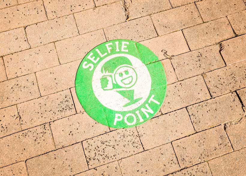 selfie-point-logos-on-the-floor-in-saintes-green-with-selfie-icon-things-to-do-in-saintes-blog-post