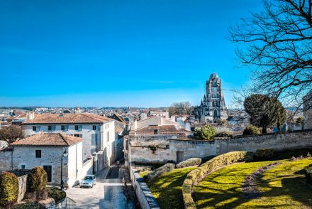 view-over-the-city-of-saintes-featuring-the-dominating-cathedrale-saint-pierre-with-its-dome-bell-tower-what-to-do-in-Saintes-blog-post